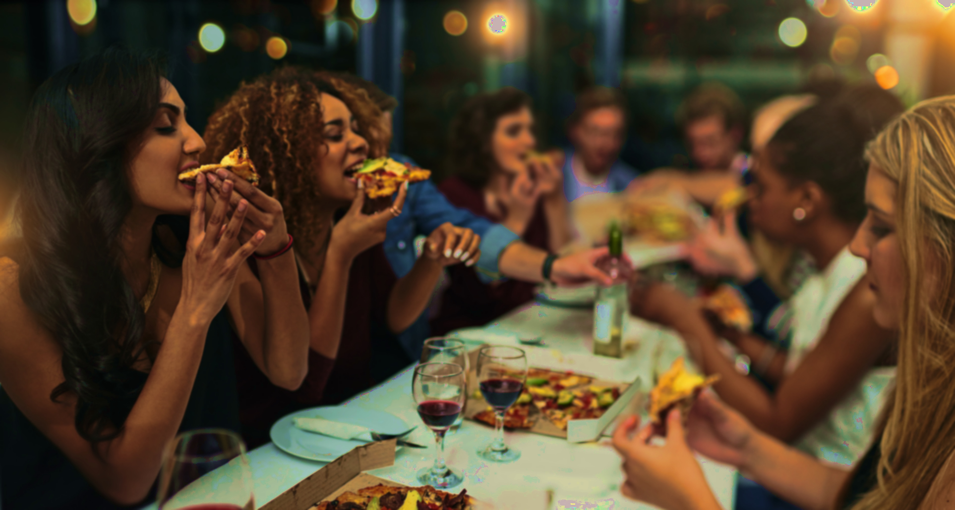 Group-of-friends-eating-pizza-and-drinking-wine